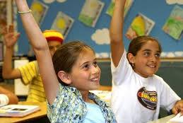 girls raising hands