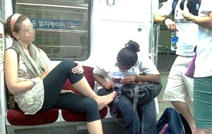 women taking up space on train